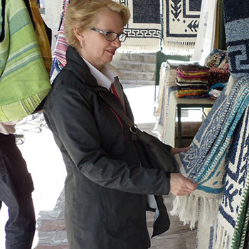 Sharon inspecting quilts
